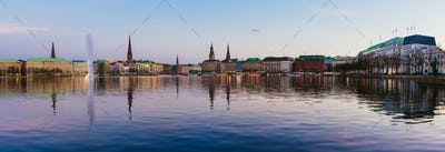 Beautiful panoramic view of Alster river and Hamburg town hall - Rathaus at spring earning evening