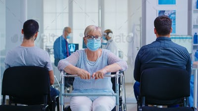 Senior woman with walker in hospital waiting area