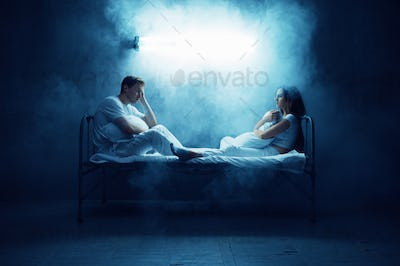 Crazy man and woman sitting in bed, psychedelics