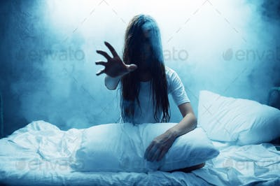Crazy woman show hand in bed, insomnia