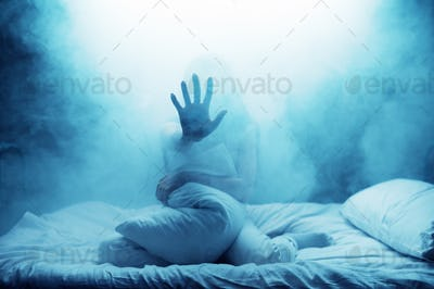 Psycho woman show hand in bed, psychedelic person