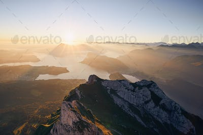 Scenic view of lake and mountains at sunrise