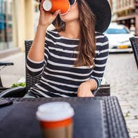 Cute female in big summer hat and sunglasses