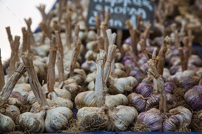 Summer village marketplace with garlic in Greece