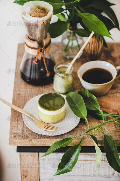 Green matcha cheesecake for dessert and brewed coffee in flask