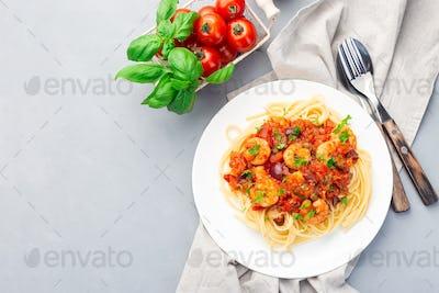 Shrimp linguine Puttanesca pasta with shrimps, horizontal, top view, copy space