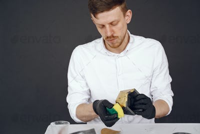 Man in a white shirt works with a cement