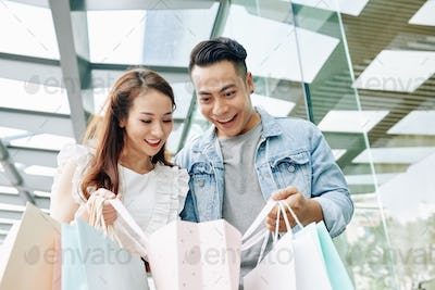 Couple looking in shopping bag