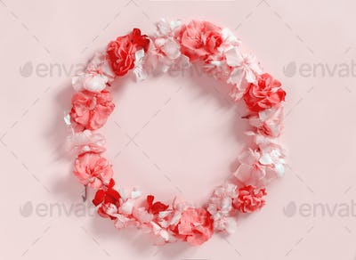 Frame of pink flowers over a pink background
