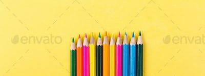 Banner of Colorful pencils on yellow background.