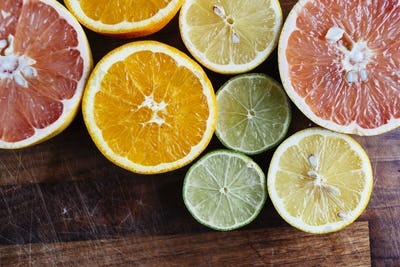 Sliced citrus fruits on chopping board