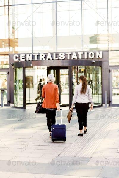 Rear view of businesswomen entering railroad station