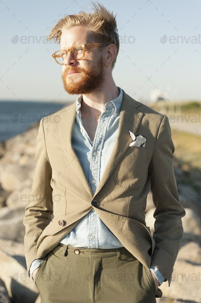 Thoughtful businessman looking away outdoors