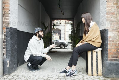 Couple talking in passage outdoors