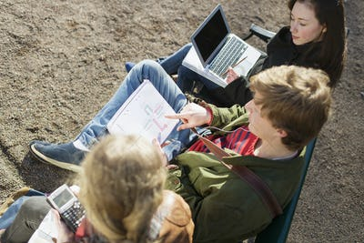 High angle view of teenage friends studying in college campus