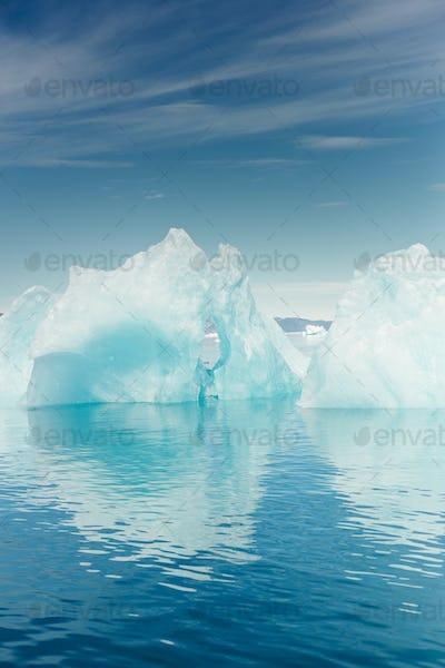 Icebergs floating on sea against sky