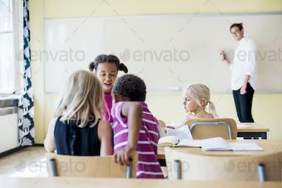 Male teacher teaching class in primary school