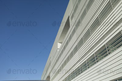 Low angle view of office building against clear blue sky