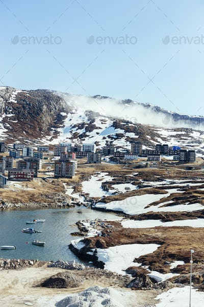 Apartment buildings on mountain during winter