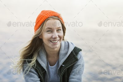 Portrait of smiling female student against river