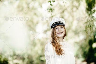Portrait of happy graduate at university park