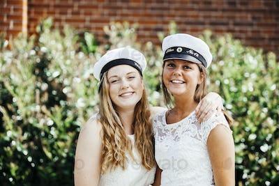 Portrait of happy female university students at graduation party