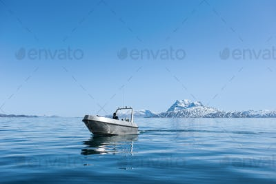Young man in boat sailing on sea against clear blue sky