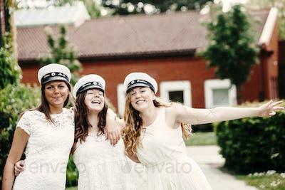 Portrait of cheerful female university students celebrating at graduation party