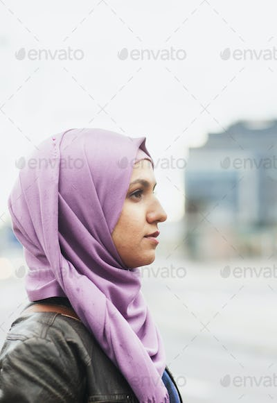 Thoughtful young woman outside railroad station