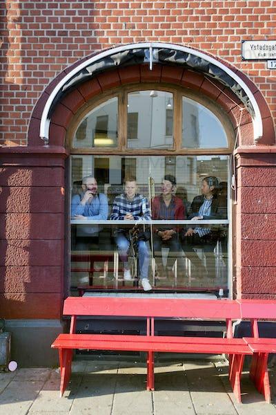 Businessmen seen through glass window of cafeteria