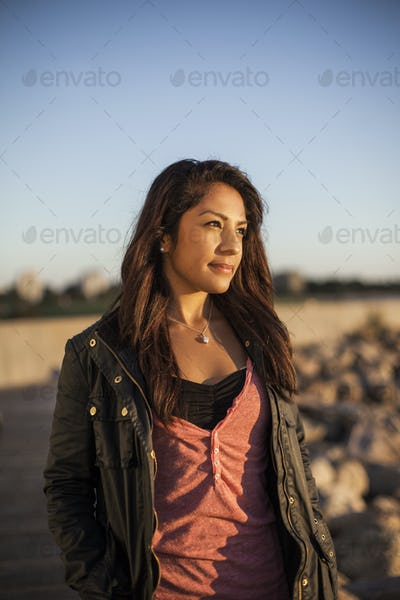 Thoughtful woman standing against clear sky