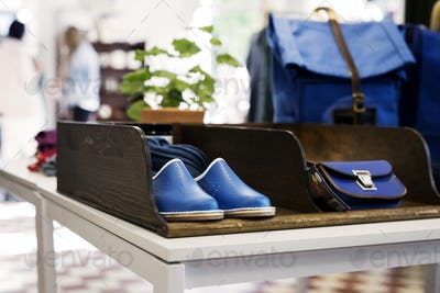 Shoes and bags displayed at store