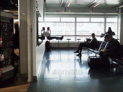Businessmen waiting at airport