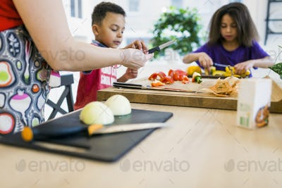 Mother with children cooking in kitchen