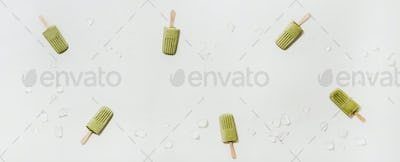 Flat-lay of green matcha coconut popsicles, copy space