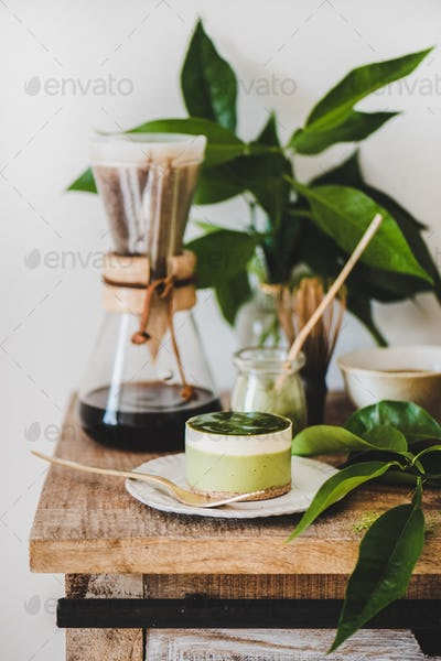 Green matcha cheesecake and brewed pour-over coffee in glass flask