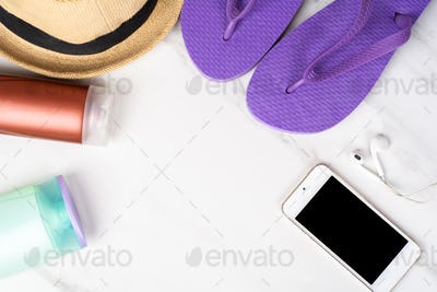 Smartphone, flip-flops, sunscreen and hat.
