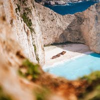 Navagio beach or Shipwreck bay. Turquoise sea water and white beach between huge rocky cliffs