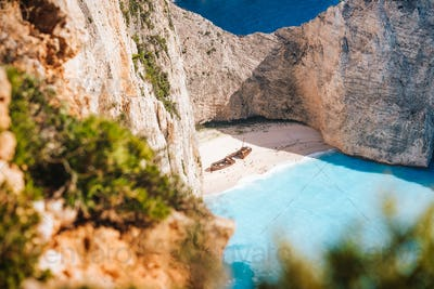 Famous shipwreck on Navagio beach. Blue sea cove surrounded by huge white limestone cliffs. Famous