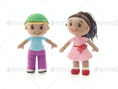 Knitted toys boy and girl on a white background