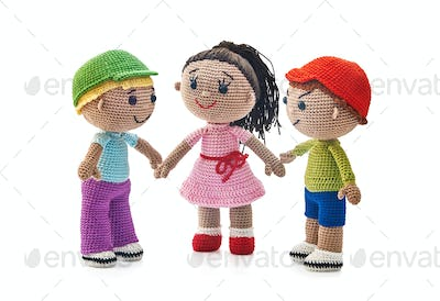 Knitted toys boys and girl on a white background