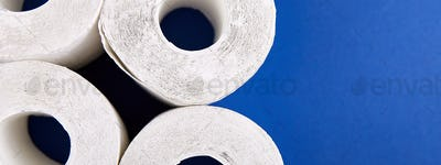 Coronavirus pandemic panic shopping concept. Flat lay of Toilet paper rolls