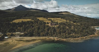 Scotland's ocean coast landscape aerial view: forests, valley, hills. Brodick castle in Arran
