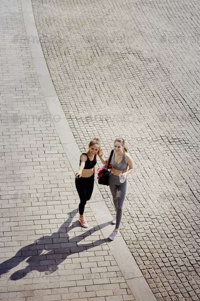 Top view two happy friends going to training