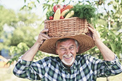 Happy farmer with basket on his head