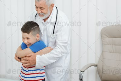 Boy on consultation with doctor in clinic