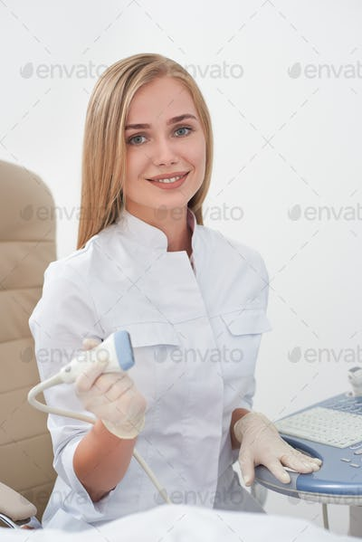 Smiling doctor with ultrasonography equipment