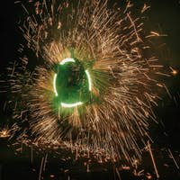 Amazing fire show at night at festival or wedding party
