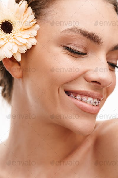 Image of beautiful young happy shirtless woman with gerber flower