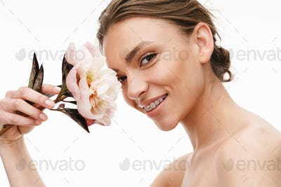 Image of beautiful caucasian young shirtless woman holding peony flower